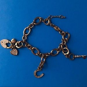Fossil charm bracelet with 3 charms